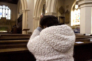 A worshiper visits the St Mary's church in Watford after the morning devotion.