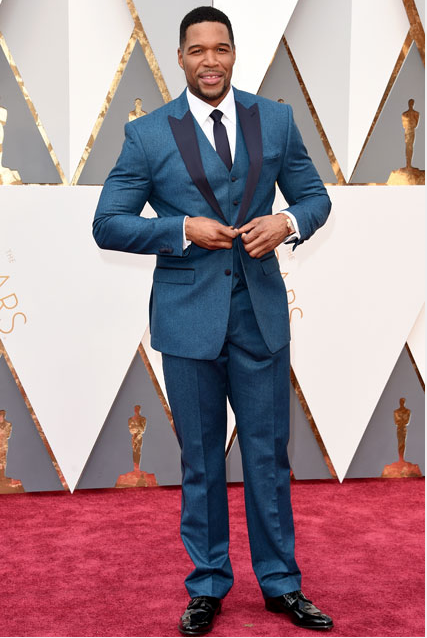Michael Strahan in a blue suit.